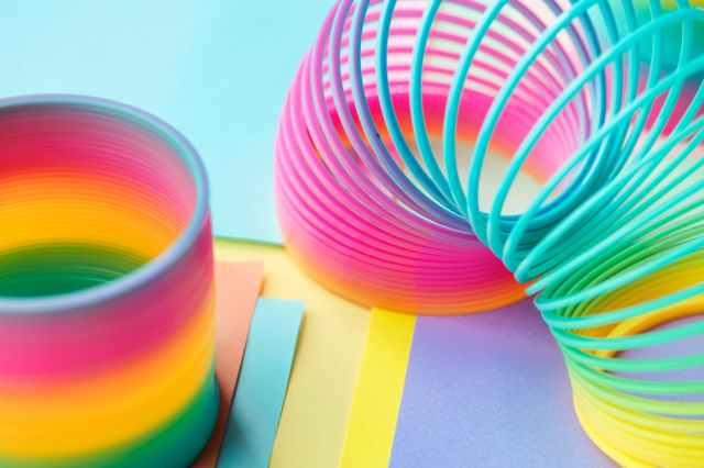 two multicolored slinky toys